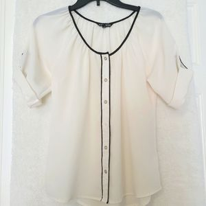 Beautiful shirt-style blouse with a round neckline